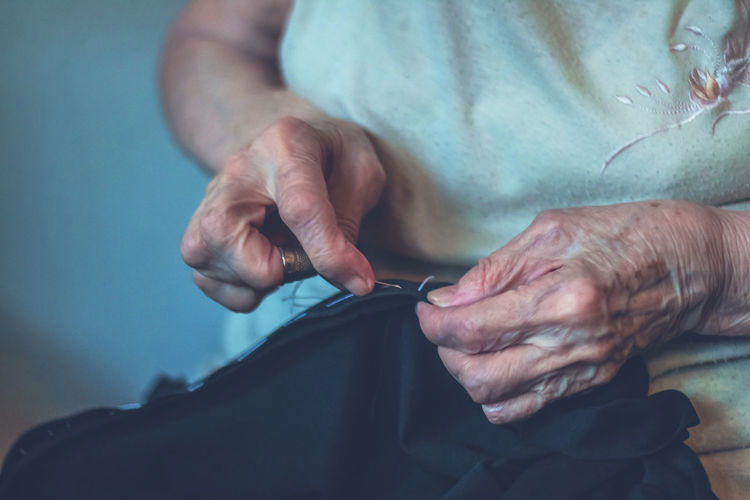 Human Hand One Person Skill  Midsection Creativity Art And Craft Senior Adult Real People Indoors  Adult Working Close-up Craft Knitting Sewing Tailor Seamstress Elderly Wrinkled Old Woman Females Textile Sewing Needle