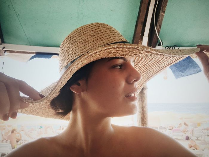 Beach Life Beach Photography Beachphotography Contemplation Day Hat Headshot Human Face Indoors  Lifestyles Long Hair Looking Away Person Serious Smile Tina Rips Tinarips Woman Hat Woman In Hat Woman In Hat Shadow Wooman Wooman Portrait Young Adult