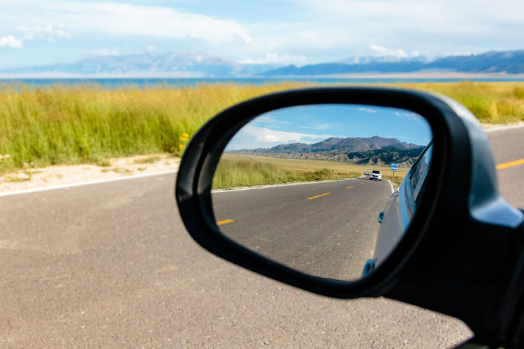 Beauty In Nature Close-up Cloud Cloud - Sky Country Road Cropped Day Focus On Foreground Grass Land Vehicle Landscape Mode Of Transport Nature No People Outdoors Part Of Rear View Mirror Reflection Road Scenics Side-view Mirror Sky Tranquil Scene Tranquility Transportation