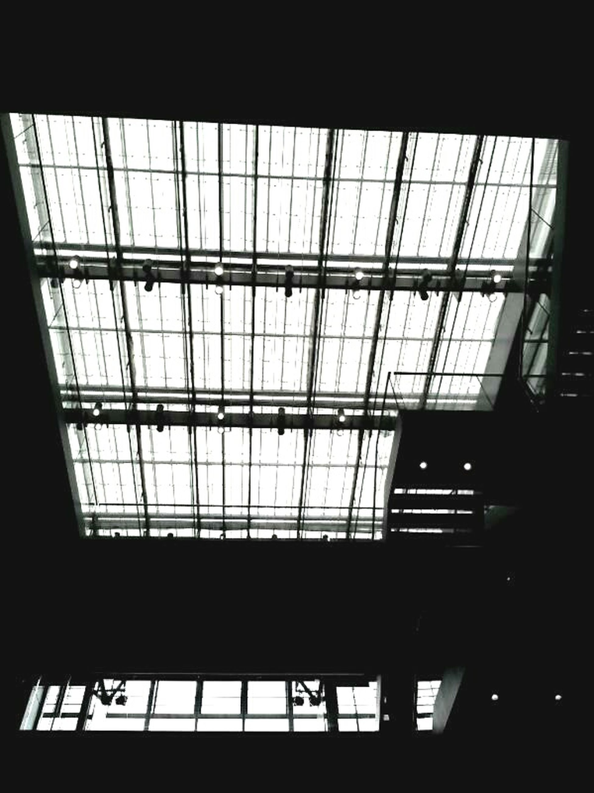 indoors, window, architecture, built structure, glass - material, transparent, ceiling, low angle view, skylight, building, glass, modern, geometric shape, no people, day, pattern, building exterior, railing, interior, architectural feature