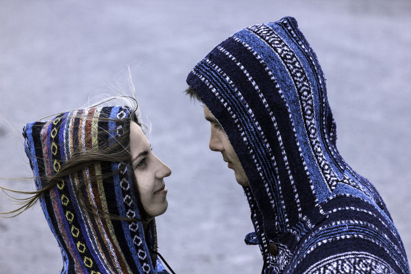 Beautiful young loving couple in traditional poncho clothes. Both heads are in hoods. Snapshot in profile, only face. Shooting in the desert. Photo with daylight. Three quarters length portrait. Couple Relationship Traditional Clothing Adult Close-up Clothing Couple - Relationship Day Focus On Foreground Hairstyle Headshot Human Face Leisure Activity Lifestyles Obscured Face Outdoors Poncho Portrait Profile View Real People Side View Warm Clothing Women Young Adult Young Women Summer Road Tripping The Portraitist - 2018 EyeEm Awards The Photojournalist - 2018 EyeEm Awards The Still Life Photographer - 2018 EyeEm Awards The Traveler - 2018 EyeEm Awards The Great Outdoors - 2018 EyeEm Awards The Creative - 2018 EyeEm Awards The Fashion Photographer - 2018 EyeEm Awards The Street Photographer - 2018 EyeEm Awards Love Is Love