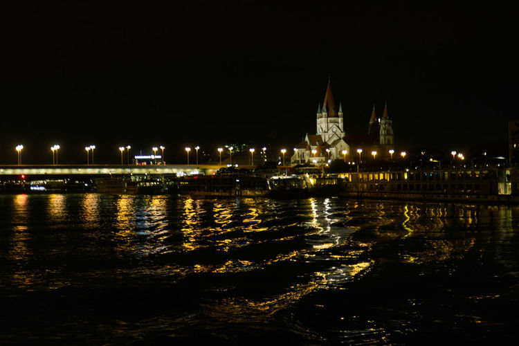 Donau Jubiläumskirche Kirche Architecture Built Structure Chain Bridge City Illuminated Nature Night No People Outdoors Reflection River Travel Travel Destinations Water Waterfront Wellen Wien