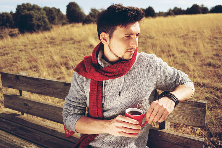 One Person Drink Young Adult Coffee Cup Food And Drink Coffee - Drink Young Men Sitting Relaxation Lifestyles Leisure Activity Mug Coffee Cup Casual Clothing Refreshment Seat Men Drinking Outdoors Contemplation