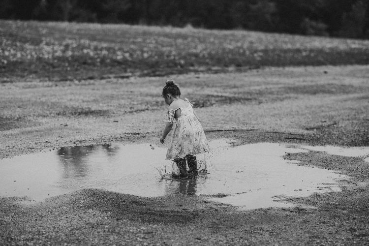 Real People One Person Nature Water Lifestyles Day Land Child Outdoors Puddle Springtime Jumping Girl Dress
