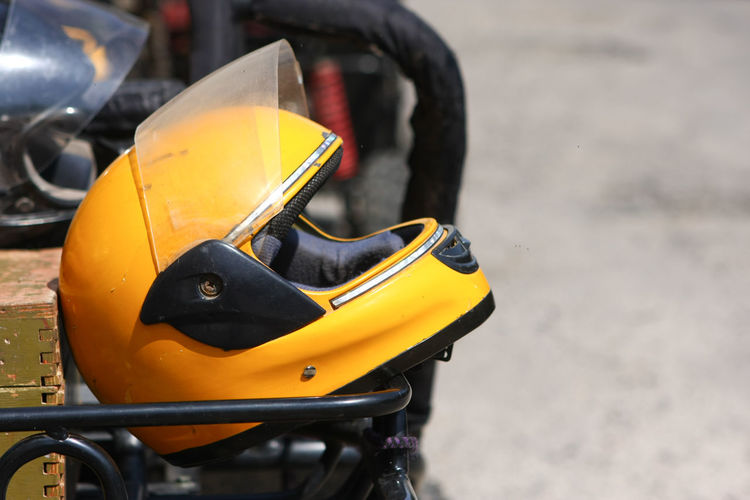 Close-up of yellow helmet on cart