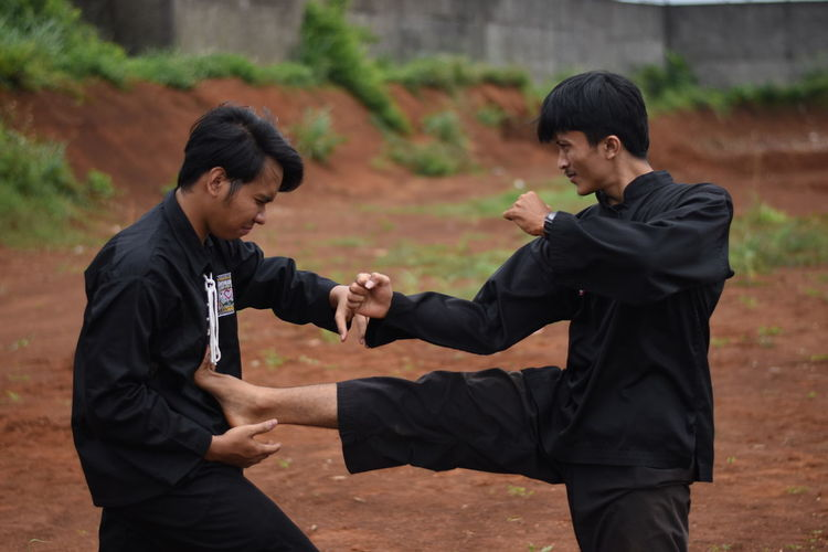 Young men practicing karate outdoors
