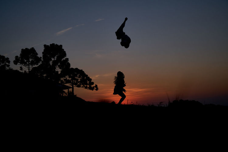 Animal Themes Animals In The Wild Beauty In Nature Bird Day Energetic Flying Full Length Landscape Leisure Activity Nature One Person Outdoors People Real People Scenics Silhouette Sky Sunset Tranquility Tree