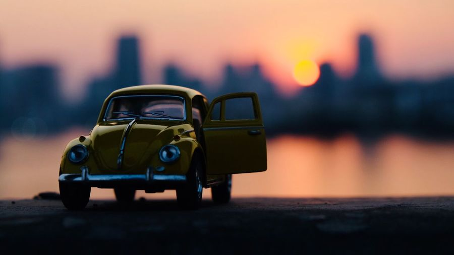 Close-up of toy car during sunset