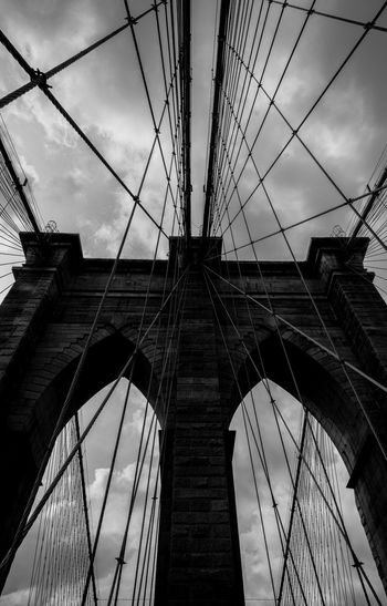 Standing tall under the clouds Be. Ready. EyeEmNewHere EyeEm Best Shots Black And White Friday Travel Destinations Travel Suspension Bridge Strength Sky Outdoors Man Made Structure Low Angle View Engineering Clouds And Sky Cloud - Sky Cable Built Structure Bridge - Man Made Structure Bridge Blackandwhite Photography Blackandwhite Architecture Brooklyn Bridge / New York Brooklyn Black & White