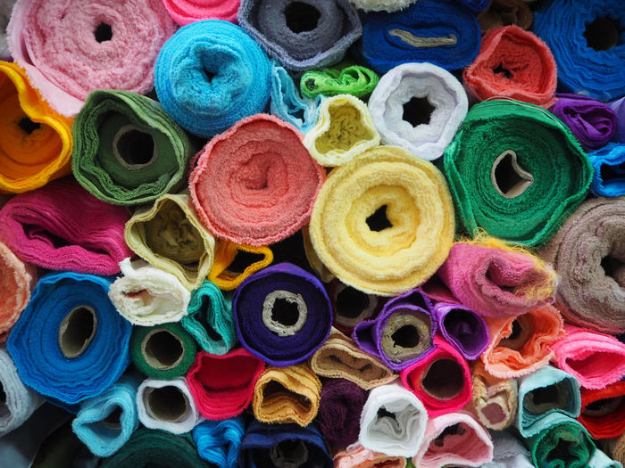 Full Frame Shot Of Colorful Fabric Rolls Pile At Store