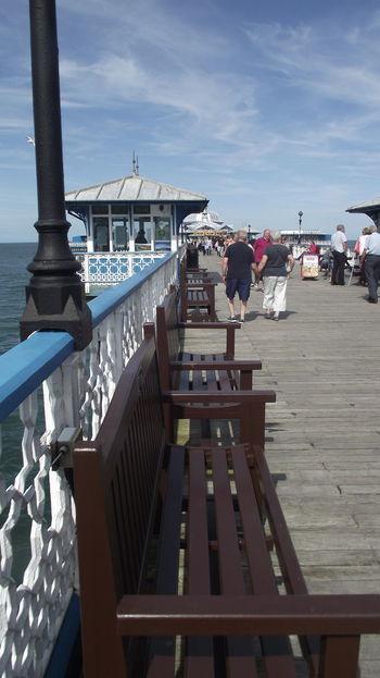 North Wales Walking Around Llandudno, United Kingdom Llandudno Coast Llandudno Blue Pier Bench View Bench Blue Sky With Clouds