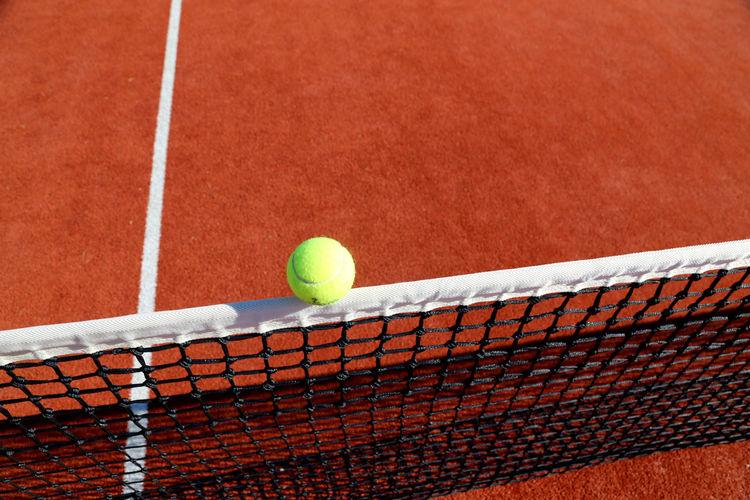 Yellow tennis ball on the floor