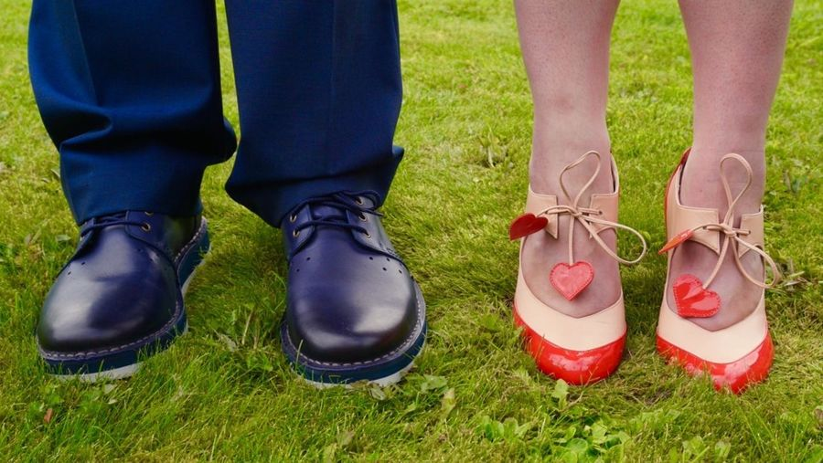 Grass Standing Person Footwear Close-up Outdoors Lawn Day Green Shoe Front View Low Section Lifestyles Occasion Formal Attire Wedding Bride Bride And Groom Groom High Heels Designer  Designer Shoes