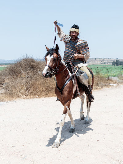 Tiberias, Israel, July 01, 2017 : Participants in the reconstruction of Horns of Hattin battle in 1187 left the camp on horseback and go to the battle site near TIberias, Israel Army Battle Cross Crusaders Field Guy De Lusignan Hattin Heat Heritage History Horn Horseman Infantry Israel Jerusalem KINGDOM Muslims Palestine Reconstruction Religion Saladin Templars Victory War Weapons