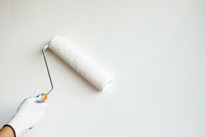 Person working on white wall
