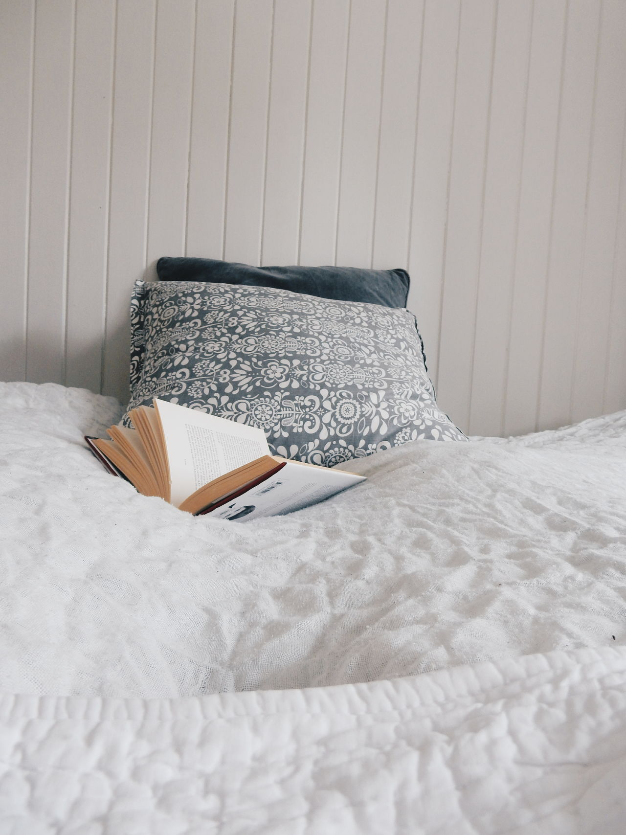 Novel on bed against wall at home