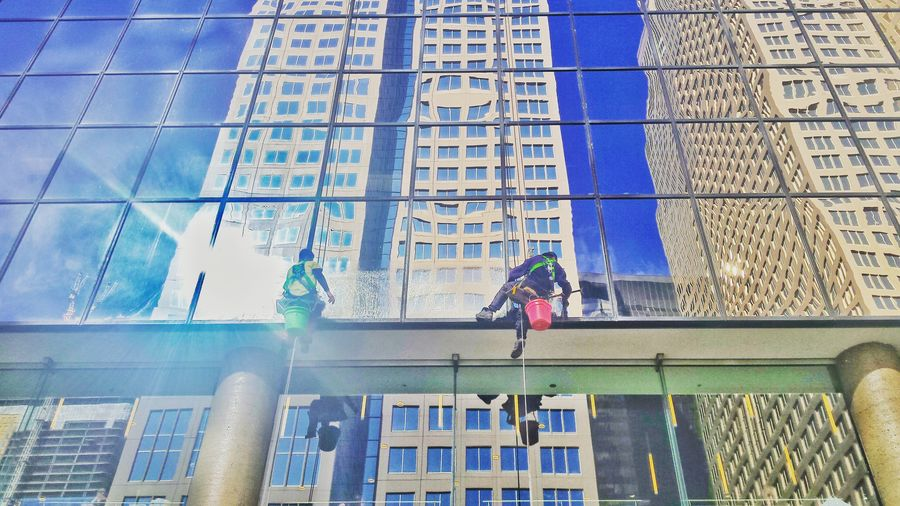 Window cleaners at work. City Street Building Exterior Built Structure Clear Sky Urban Blue Building Heights Clouds And Sky Architecture People At Work Window Cleaner Showcase April Blue Wave Eyeemawards16