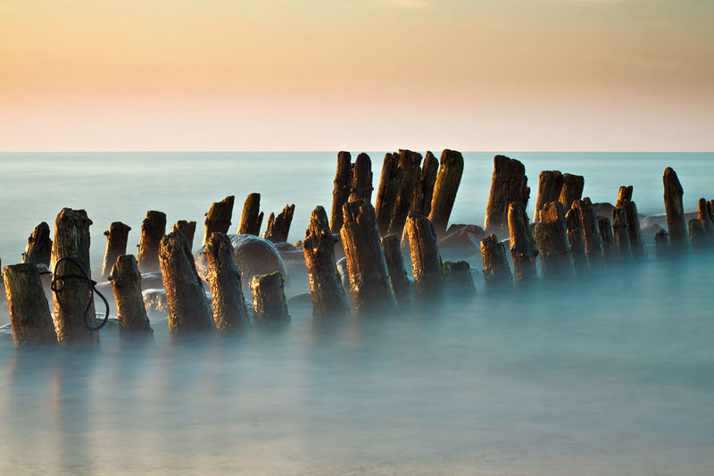 Groynes on the Baltic sea coast. Baltic Sea Beach Beauty In Nature Day Evening Groyne Groynes Horizon Over Water Landscape Long Exposure Nature No People Outdoors Scenics Sea Sky Sundown Sunset Tranquil Scene Tranquility
