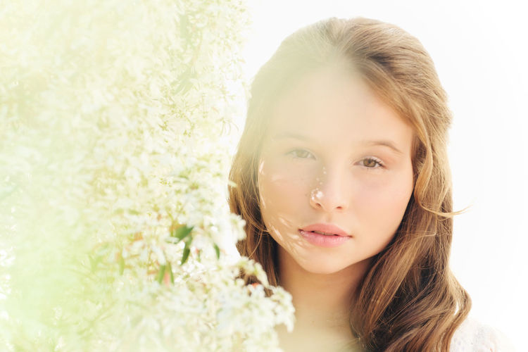 Close-up portrait of girl with flower