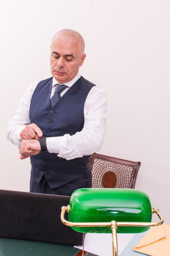 Businessman checking the time in office