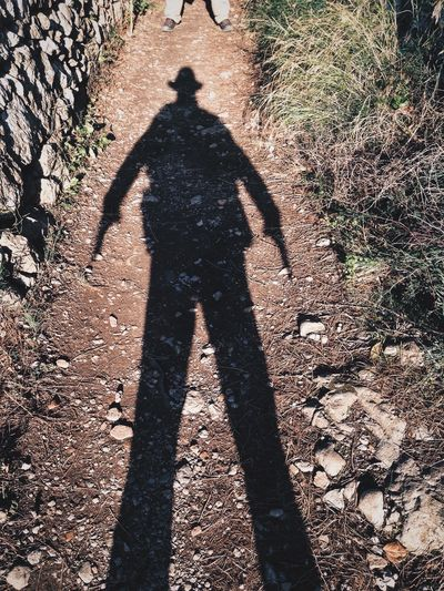 Man with shadow like in a Wild West movie Man Shadow Silhouette Cowboy Wildwest Duel One Person The Portraitist - 2016 EyeEm Awards