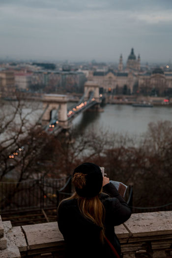 seasons changing River River Danube Budapest Budapest, Hungary Winter Gloomy Cityscape City Life Back View City Cityscape Women Rear View Sky Architecture Urban Skyline Waterfront Bridge - Man Made Structure Autumn Mood