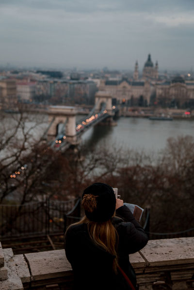 seasons changing River River Danube Budapest Budapest, Hungary Winter Gloomy Cityscape City Life Back View City Cityscape Women Rear View Sky Architecture Urban Skyline Waterfront Bridge - Man Made Structure