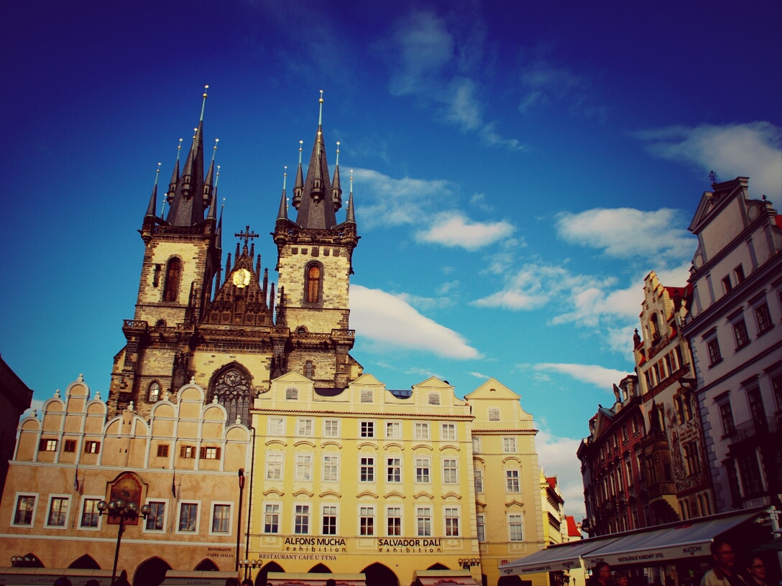 architecture, building exterior, built structure, sky, city, low angle view, travel destinations, facade, history, church, travel, famous place, incidental people, tourism, religion, place of worship, blue, old town, cathedral