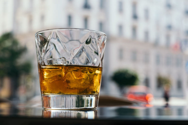 Close-up of whiskey in glass on table