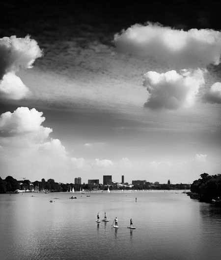 Scenic view of lake in city against sky