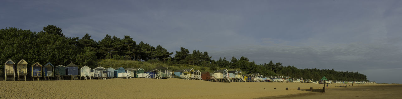 Beach Huts At Wells Next To Sea Architecture Beach Beauty In Nature Built Structure Cloud - Sky Day Environment In A Row Land Landscape Nature Outdoors Plant Sand Scenics - Nature Sky Tranquil Scene Tree Water