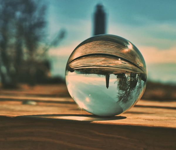 Lensball Sphere Reflection Close-up Focus On Foreground Glass - Material Transparent No People Upside Down Shape Day Single Object Sky Sunlight Ball Nature Crystal Ball Outdoors Table Sunset Geometric Shape