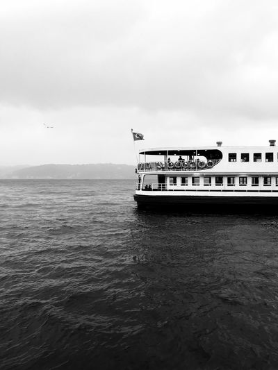 Half. Water Nautical Vessel Sky Mode Of Transportation Transportation Sea Day Cloud - Sky Nature No People Waterfront Ship Tranquil Scene Beauty In Nature Tranquility Scenics - Nature Outdoors Travel Text Passenger Craft