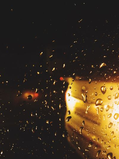 When relentless rain beats down on your window and you snap a picture of it. Drop Wet Window Transparent Rain Indoors  Glass - Material Water Illuminated Season  Weather RainDrop Backgrounds Night Car Lighting Equipment Full Frame Rainy Spotlight Purity