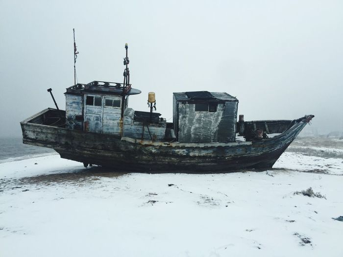 Side view of abandoned boat on the beach