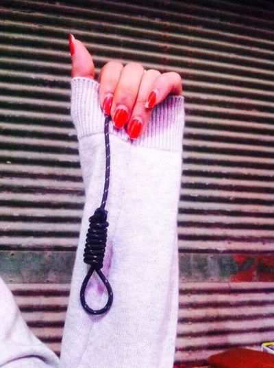 Adult Close-up Human Hand Nooseknot Striped