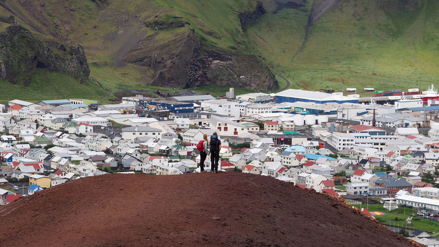 Iceland Vestmannaeyjar Adult Architecture Building Exterior Built Structure Day Environment Full Length Land Lava Lifestyles Men Mountain Mountain Range Nature Outdoors People Real People Standing Transportation Volcano Walking Women