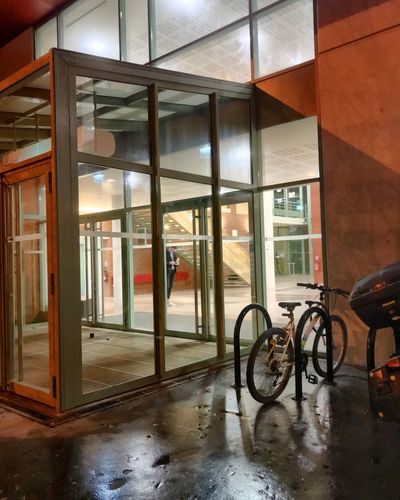 Université Bicycle Architecture Transportation Mode Of Transportation Land Vehicle Built Structure Glass - Material Window No People Wet Reflection