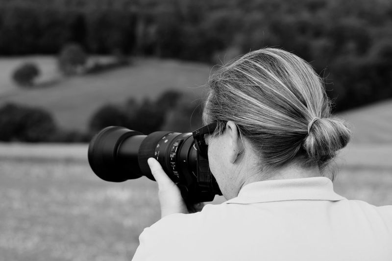 My Sister at Work EyeEm Selects Camera - Photographic Equipment One Person Photography Themes Headshot Technology Real People Photographing Focus On Foreground Photographic Equipment Activity Digital Single-lens Reflex Camera Camera Women Portrait Lifestyles