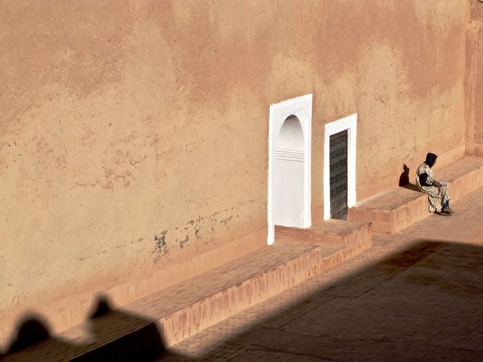 Taourirt kasbah Alone EyeEm Selects Solitary Sunlight UNESCO World Heritage Site Absence Arabic Architecture Berber  Building Building Exterior Built Structure By Himself Clothing Conceptual Concrete Copy Space Courtyard  Day Hood Kasbah Men Nature No People One Person Outdoors Shadow Simplicity Sunlight Taourirt Traditional Unrecognizable Person Wall Wall - Building Feature Window
