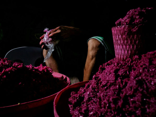 EyeEmPHLaborDay2017 Eyeem Philippines One Person One Man Only Adult Human Body Part Working Black Background Close-up Day Human Hand Vendor Pink Market Labor Day Break The Mold Working People Shrimp Paste The Week On EyeEm The Street Photographer - 2017 EyeEm Awards The Photojournalist - 2017 EyeEm Awards