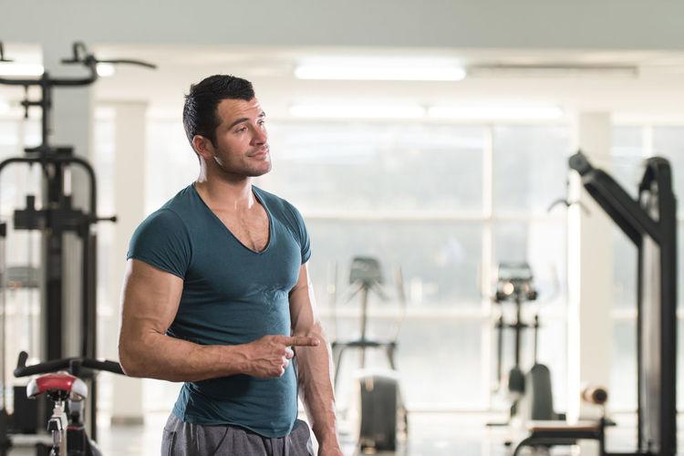 Mid adult man standing indoors