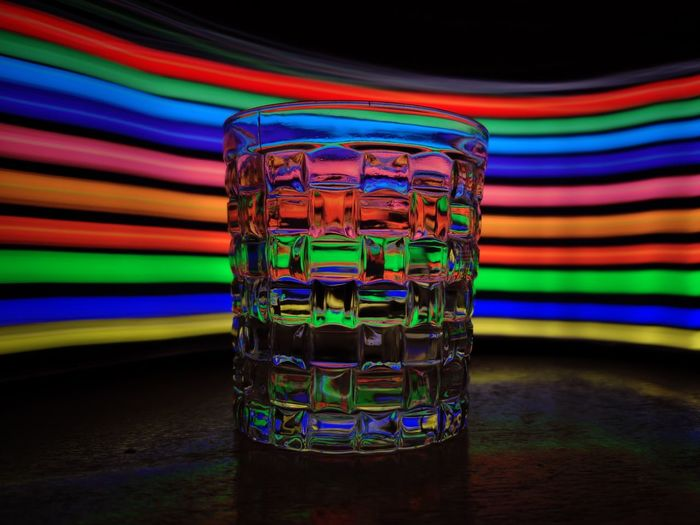 Close-up of multi colored glass on table