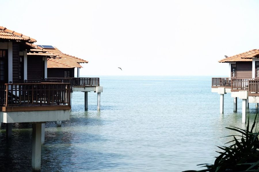 Sea Built Structure Architecture Water Clear Sky Building Exterior Tranquility Stilt Day Tranquil Scene Outdoors Horizon Over Water No People Stilt House Nature Scenics Beauty In Nature Sky Blue Water Clear Sky Summer Day Vacation Destination Getaway  Weekend Getaway Tourist Destination Travel