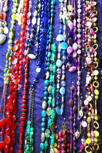 Abundance Backgrounds Bracelet Choice Close-up Collection Colorful Day For Sale Full Frame Group Of Objects Halsketten Jewelry Large Group Of Objects Market Multi Colored Necklace Necklaces No People Ornament Outdoors Retail  Variation