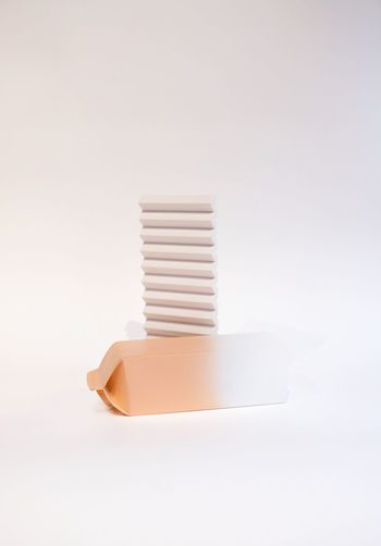 Close-up of stack of paper over white background