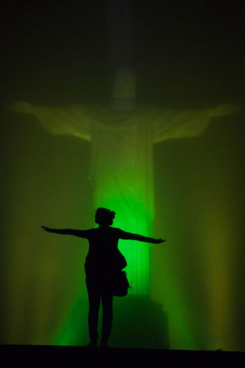 Cristo Redentor Green Color Rio De Janeiro Dancing Front View Full Length Holding Illuminated Leisure Activity Lifestyles Music Musician Night Nightlife One Person Performing Arts Event Real People Silhouette Skill  Stage - Performance Space Stage Light Standing Three Quarter Length Women