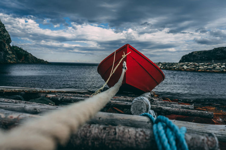 Rope Tied To Boat In Sea Against Sky