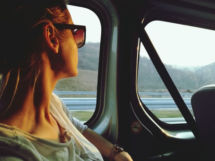 Travel Transportation Window Journey Headshot Freedom Vehicle Interior Adults Only Sunglasses Adult Vacations Young Adult Day One Person Car One Woman Only People Car Interior Adventure Sky The Portraitist - 2017 EyeEm Awards Let's Go. Together. EyeEm Selects