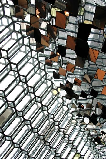 Low Angle View Of Patterned Glass Ceiling At Harpa
